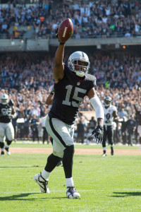 September 20, 2015; Oakland, CA, USA; Oakland Raiders wide receiver Michael Crabtree (15) scores a touchdown against Baltimore Ravens defensive back Kyle Arrington (24, right) during the third quarter at O.co Coliseum. The Raiders defeated the Ravens 37-33. Mandatory Credit: Kyle Terada-USA TODAY Sports