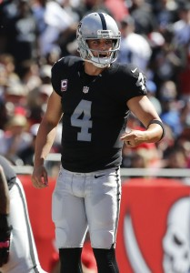 Oct 30, 2016; Tampa, FL, USA; Oakland Raiders quarterback Derek Carr (4) calls a play against the Tampa Bay Buccaneers during the second quarter at Raymond James Stadium. Mandatory Credit: Kim Klement-USA TODAY Sports